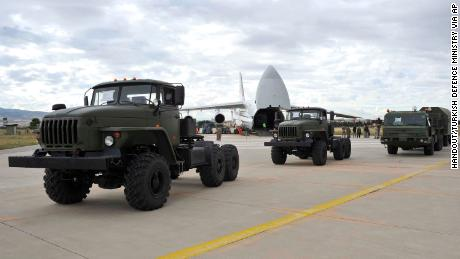 Military vehicles and equipment, including parts of the S-400 air defense systems, are unloaded from a Russian transport aircraft in Ankara on Friday, July 12, 2019.