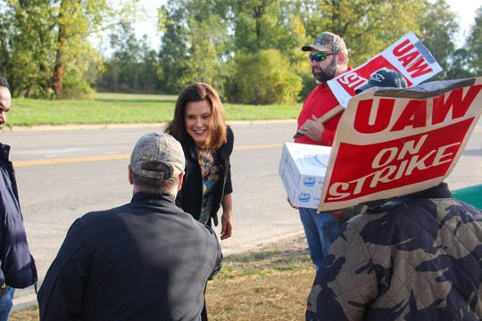 Michigan Gov. Gretchen Whitmer visited United Auto Workers' members on strike at General Motor Co.'s Delta Township Assembly plant near Lansing.