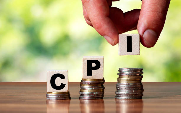 CPI - Customer Price Index word symbol - business concept. Hands put wooden block on stacked increasing coins CPI - Customer Price Index word symbol - business concept. Hands put wooden block on stacked increasing coin. cpi stock pictures, royalty-free photos & images