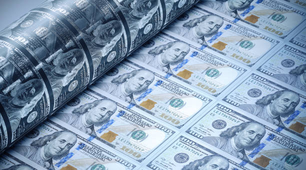 One Hundred American Dollars Being Printed - Money Printing Concept One hundred American dollars being printed. Selective focus. Horizontal composition with copy space. Money printing concept. inflation up stock pictures, royalty-free photos & images